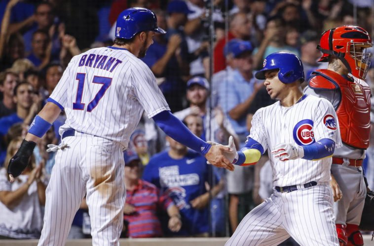 Chicago Cubs' Willson Contreras, right, celebrates with Kris Bryant, left, after hitting a two-run home run off St. Louis Cardinals starting pitcher Michael Wacha during the sixth inning on Sunday in Chicago. (AP Photo/Kamil Krzaczynski)