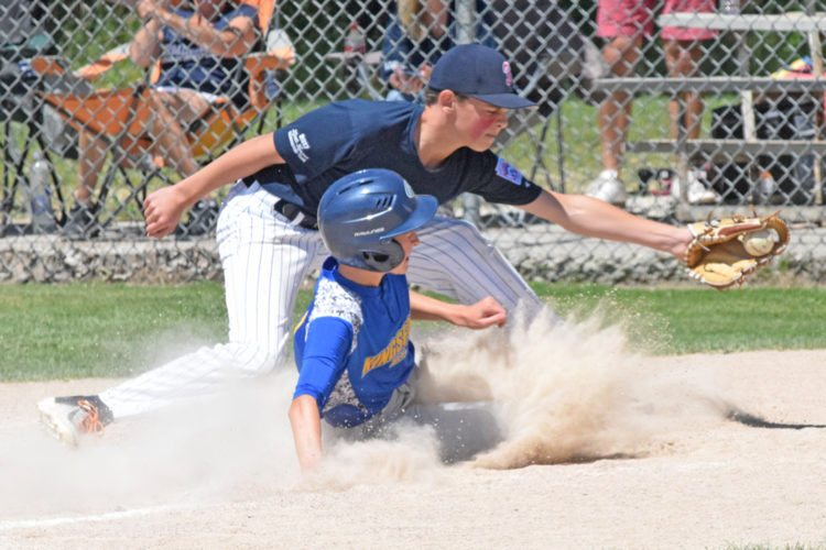 Kingsford's Dylan Bousley slides safely into home plate ahead of the tag from Birmingham pitcher Ben Catlin in the second inning of Monday's Little League Boys Major state quarterfinal game at Howes Field. (Mike Mattson/The Daily Press)