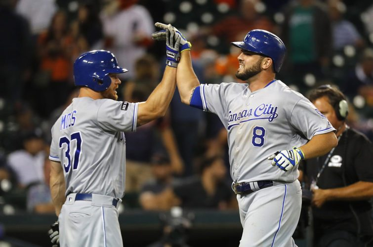 Kansas City Royals' Mike Moustakas (8) celebrates his solo home run against the Detroit Tigers with Brandon Moss (37) in the 12th inning in Detroit on Monday. (AP Photo/Paul Sancya)