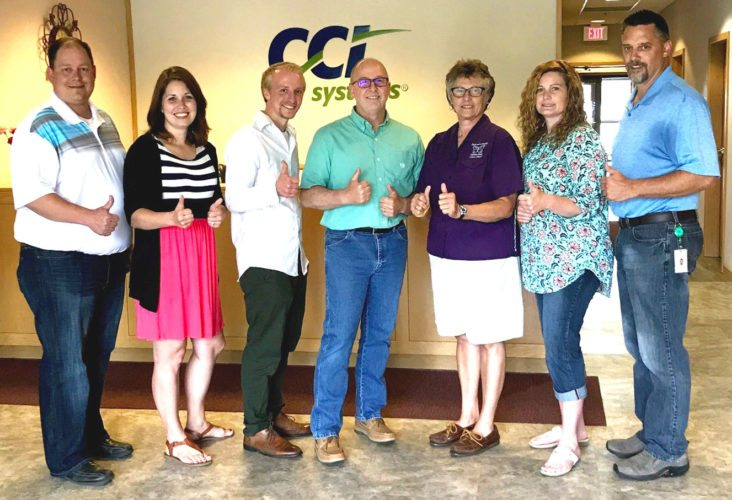 CCI SYSTEMS EMPLOYEES donated $1,000 from an employee event to the Dickinson County Cancer Loan Closet. Shown here, from left, are CCI employees Dan Kallio, Sonja Matzke, Nick Hurzeler and Rick Hurzeler; Diane Schabo, president of the loan closet; and CCI employees Gwen Jones and Dan Plante.