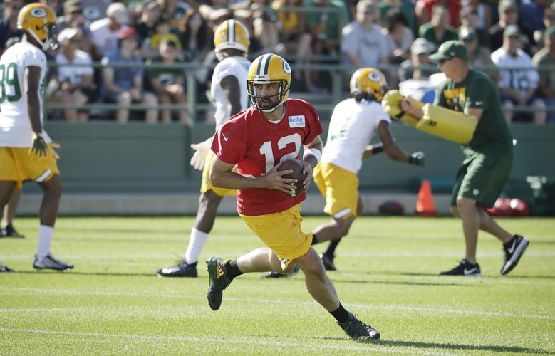 Green Bay Packers' Aaron Rodgers runs during NFL training camp July 27 in Green Bay, Wis. (AP Photo/Morry Gash)
