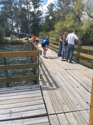 Students in Jeff Christensen's Building for Wildlife project-based learning class at Iron Mountain Public Schools partnered with Wildlife Unlimited to stain and update the fishing pier on Lake Antoine this spring.