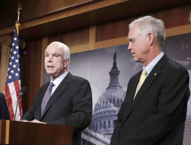 SEN. RON JOHNSON, R-Wis., right, appears with Sen. John McCain, R-Ariz., July 27 on Capitol Hill in Washington. (AP Photo/J. Scott Applewhite)