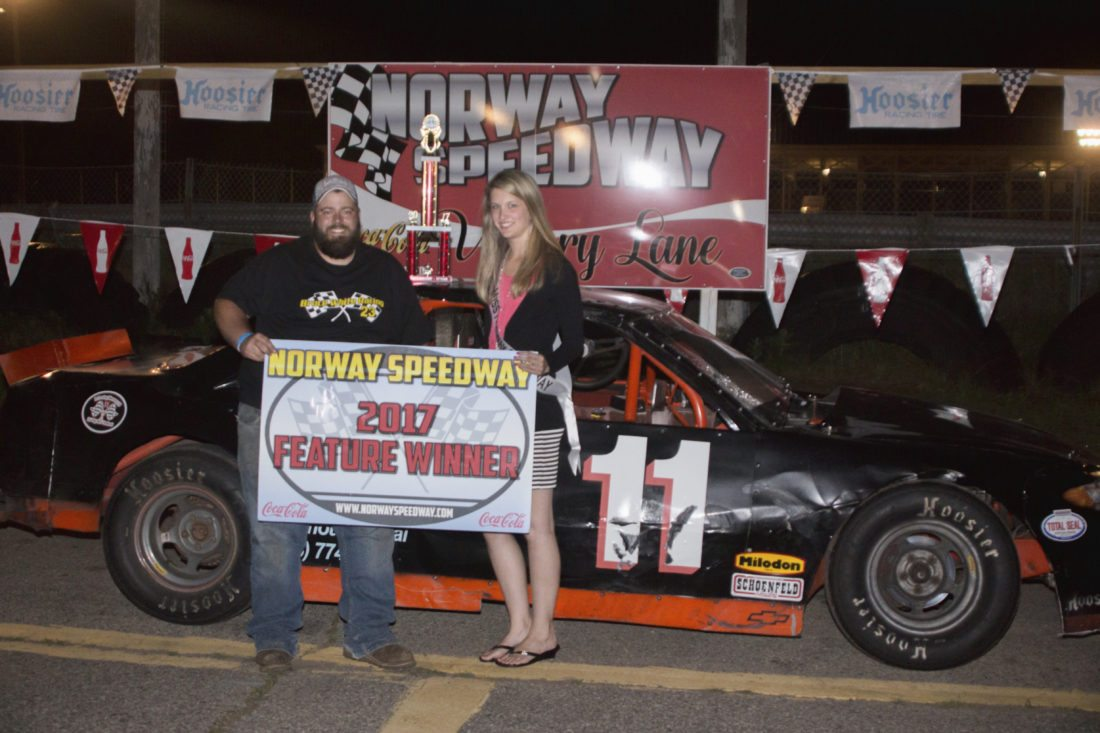 Courtesy Photo/Tim Soper Jesse Hedlund came out of retirement to drive his late father's car at Norway Speedway. He honored Ed Hedlund by winning the Sportsman Division feature. Jesse Hedlund is pictured with Miss Norway Speedway Jamie Meyers.