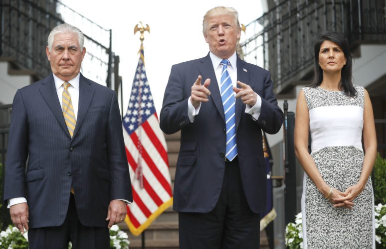 PRESIDENT DONALD TRUMP speaks after meeting Friday with Secretary of State Rex Tillerson, left, and U.S. Ambassador to the United Nations Nikki Haley at Trump National Golf Club in Bedminster, N.J. (AP Photo/Pablo Martinez Monsivais)
