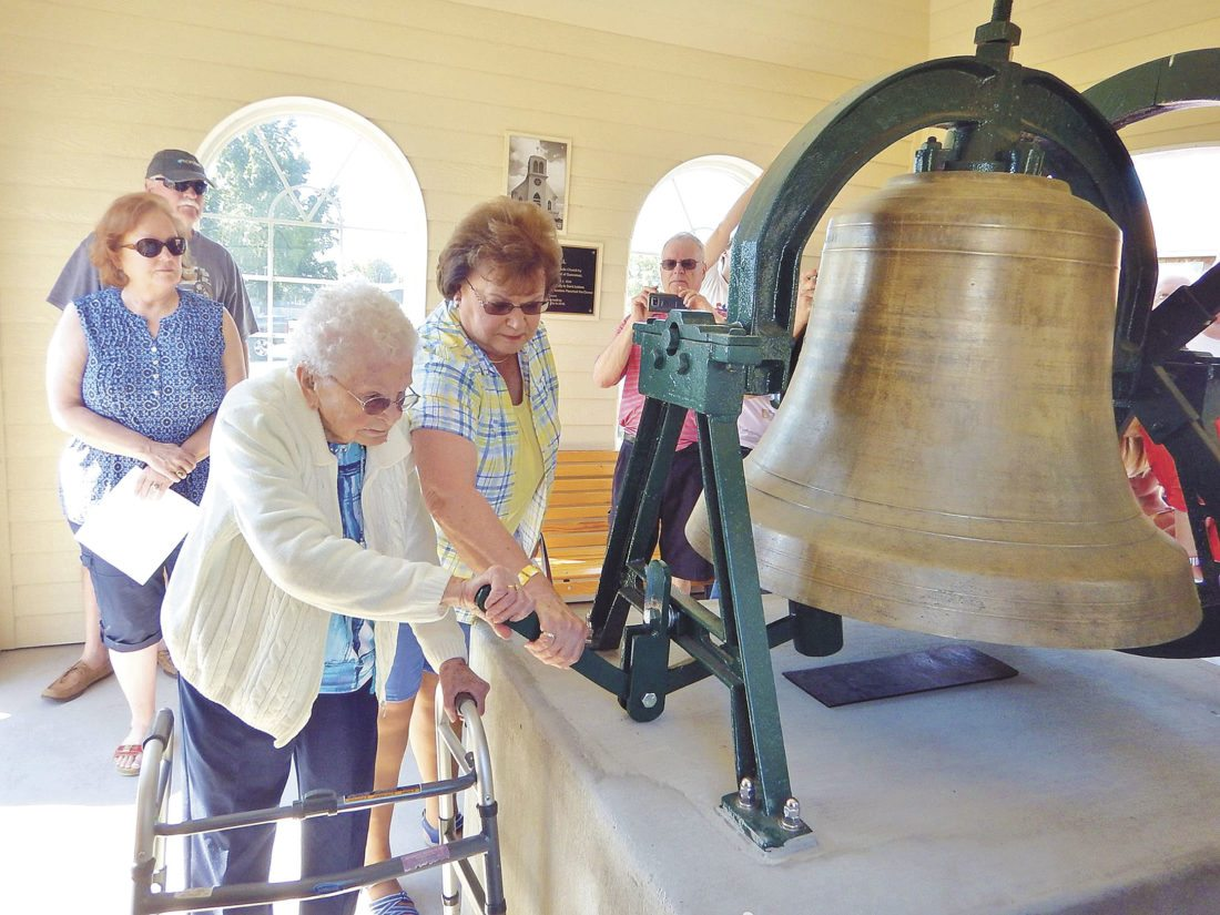 ELEANOR PANCHERI, 99, tolls the bell in memory of her father, Isadore Pancheri. Eleanor is the last living sibling of Isadore and Mamie Pancheri. Eleanor recalled the original dedication of the bell in 1934 as a young girl.