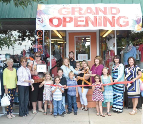 Chris Tomassucci/Daily News Photo A GRAND OPENING and ribbon cutting ceremony marked the opening of a new business in Iron Mountain's downtown — Consignment Mamas LLC. Shown here from left in the front row are Dickinson Area Chamber Alliance ambassador Greta Michaud; Lynda Zanon, chamber director; ambassador Trisha Peterson; Alicia Hebert, Carson Hendricks, Braeden Hendricks, Gavin Hendricks, Mackenzie Maenpaa, Jordan Maenpaa, and ambassadors Terese Schettler and Tamara Juul. In the second row from left are co-owners Danielle Hebert; Cassondra Hendricks holding her daughter Natalie, and Ashley Maenpaa. In the back row is Patrick Hendricks.