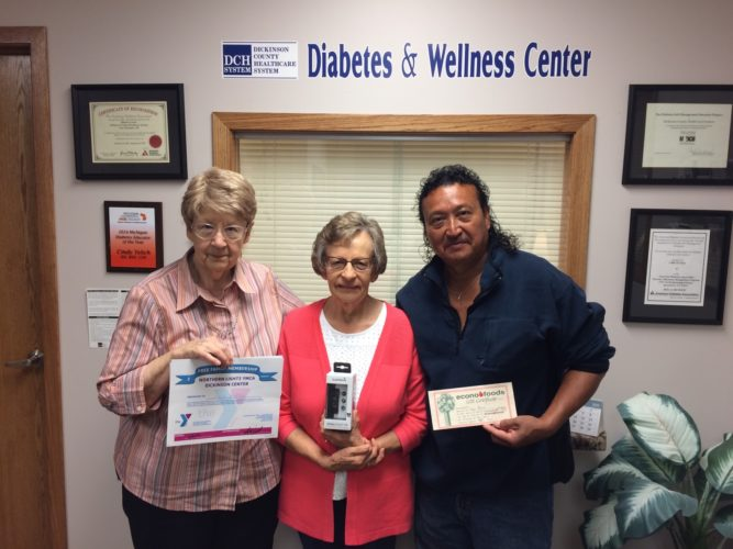 THE PRIZE WINNERS at a diabetes prevention event hosted by Dickinson County Healthcare System's Diabetes and Wellness Center were, from left, Joyce Butsic, three-month YMCA membership; Karen Wertanen, Fitbit watch; and Omar Flores, $100 Econo Foods gift card.