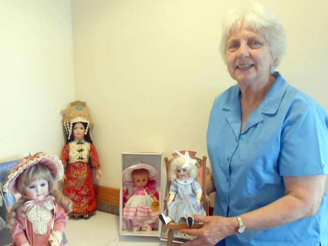 Arlene Vlies of Pelican Lake recently spoke to the Enchanted Doll Club about the merits of collecting reproductions of rare and expensive dolls. Vlies is surrounded by reproductions of antiques she has collected over the years.