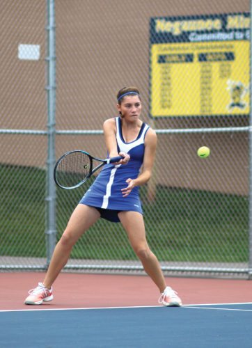 West Iron's Katarina Serbentas plays a first singles match against Negaunee Friday in Negaunee. (Rachel Oakley/The Mining Journal)