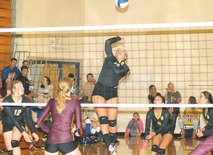 Iron Mountain's Riley Poupore (13) goes up for a spike against Menominee's Hannah Ries (1) in Saturday's Kingsford Invitational volleyball tournament. Teammates Claire Czernek (12), Taylor Talerico (2) and Ella Fortner (14) look for a rebound. (Theresa Proudfit/The Daily News)