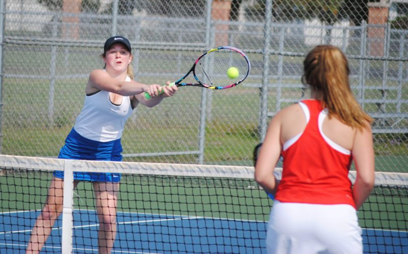 Kingsford's Carly Schneider returns a shot to Marquette in their No. 1 doubles match Monday. Schneider and Kenzie Schwamlein fell to Rachael Hunt and Ashlee Tripp 6-1, 7-5. (Burt Angeli/The Daily News)