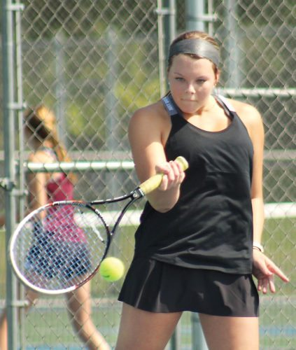 Iron Mountain No. 1 singles Saylor Swartout returns a shot in last week's girls tennis opener. Swartout downed Gwinn's Taylor Janesi 6-0, 6-0 on Tuesday. (Theresa Proudfit/The Daily News)