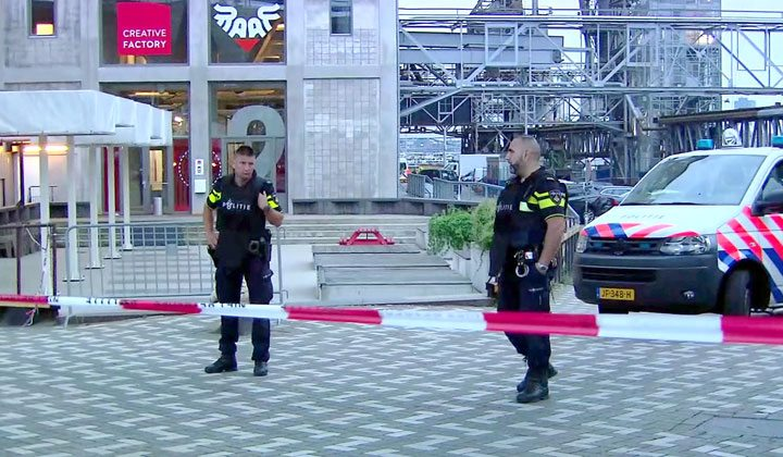 RTL via AP OFFICERS STAND BEHIND a cordoned-off area in Rotterdam in the Netherlands after a concert by an American rock band was cancelled Wednesday night due to a threat, the city's mayor said. Police detained the driver of a van with Spanish license plates carrying a number of gas tanks inside.