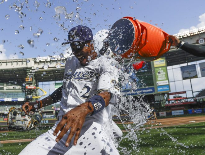 Milwaukee Brewers' Keon Broxton is dunked after making a game-saving catch in the ninth inning against the St. Louis Cardinals on Wednesday in Milwaukee. The Brewers won 6-5. (AP Photo/Morry Gash)