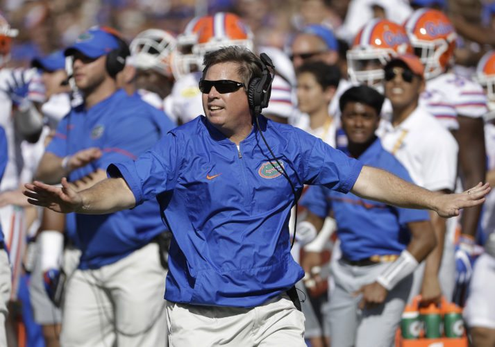 Florida head coach Jim McElwain reacts to a dropped pass by Iowa during the first half of the Outback Bowl in Tampa, Fla. in January. Two more Gators were suspended ahead of the season-opener against Michigan on Saturday. (AP Photo/Chris O'Meara, File)