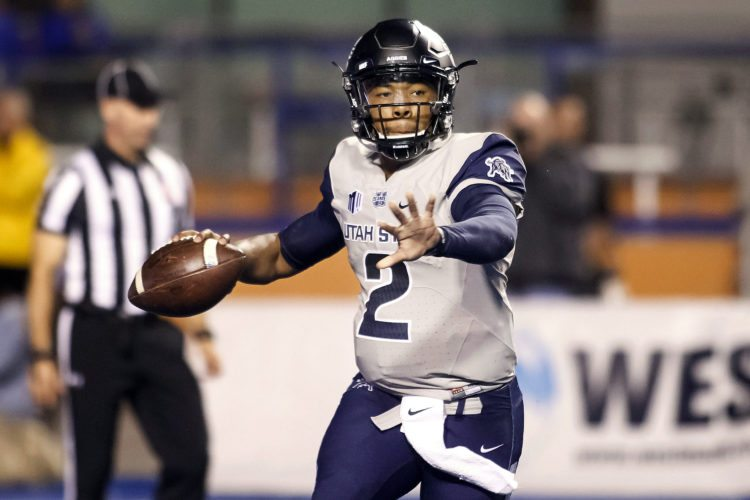 Utah State quarterback Kent Myers (2) looks for a receiver during a 2016 game against Boise State in Boise, Idaho. Myers will face Wisconsin on Friday. (AP Photo/Otto Kitsinger, File)