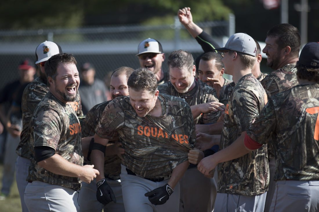 The Fox Cities Squatches celebrate an 8-5 win for the UP Hardball Tournament championship after Brian Henschle, center, hit a three-run walkoff home run. (Adam Niemi/The Daily News)