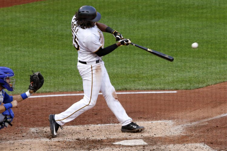 Pittsburgh Pirates' Josh Bell drives in a run with a single off Chicago Cubs relief pitcher Rob Zastryzny in the fifth inning in Pittsburgh on Monday. (AP Photo/Gene J. Puskar)