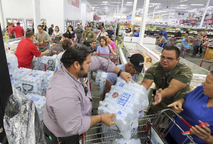 RESIDENTS PURCHASE WATER Tuesday at BJ Wholesale in Miami in preparation for Hurricane Irma, now a Category 5 storm. (Roberto Koltun/Miami Herald via AP)