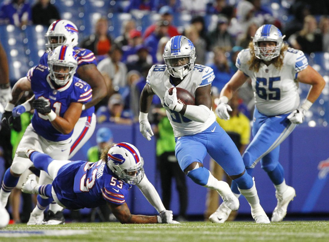 Detroit Lions&#039 Adairius Barnes runs for a touchdown during a preseason game against the Buffalo Bills on Aug. 31 in Orchard Park N.Y