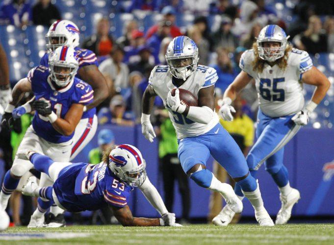 Detroit Lions' Adairius Barnes (38) runs for a touchdown during a preseason game against the Buffalo Bills on Aug. 31 in Orchard Park, N.Y. (AP Photo/Jeffrey T. Barnes)