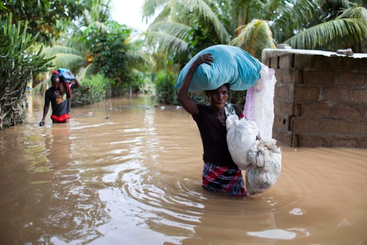 AP Photo  Assilia Joseph, right, and her son Wisner Jean Baptiste, carry their belongings they salvaged from their flooded home after the passing of Hurricane Irma, in Fort-Liberte, Haiti, Friday. Irma rolled past the Dominican Republic and Haiti and battered the Turks and Caicos Islands early Friday with waves as high as 20 feet.