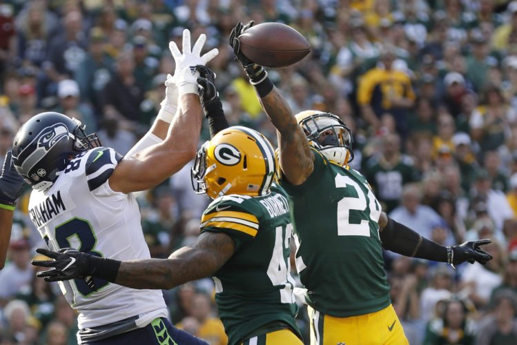 Green Bay Packers' Quinten Rollins (24) breaks up a pass intended for Seattle Seahawks' Jimmy Graham on Sunday in Green Bay, Wis. (AP Photo/Jeffrey Phelps)