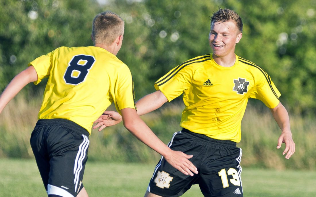 Ryan Hakamaki, right, celebrates with Tyler Fox after Fox scored the only goal in Iron Mountain's 1-0 win on Monday in Ironwood. (Jason Juno/The Daily Globe)