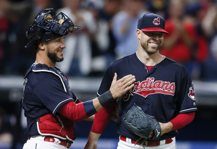 Cleveland Indians starting pitcher Corey Kluber, right, and catcher Yan Gomes celebrate a 2-0 win against the Detroit Tigers on Tuesday in Cleveland. (AP Photo/Ron Schwane)