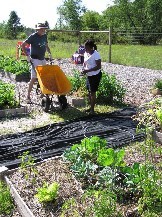 Mike and Mary Butterfield volunteer at the Crossroads Community Garden in Florence, Wis. The garden, located on Woodward Avenue, will host a harvest party on Thursday from 4 to 6 p.m.
