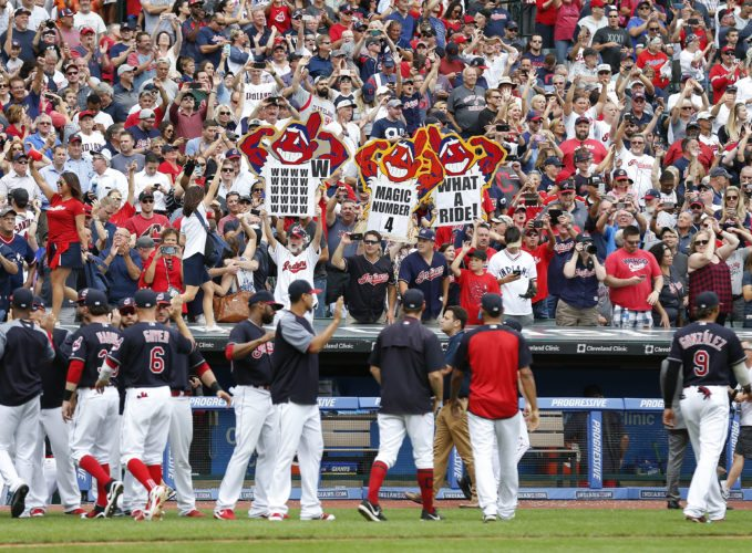Cleveland Indians fans celebrate a 5-3 victory over the Detroit Tigers on Wednesday in Cleveland. The Indians set the American League record with 21 consecutive wins. (AP Photo/Ron Schwane)