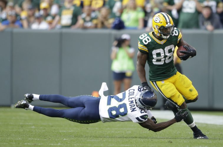 Green Bay's Ty Montgomery gets away from Seattle's Justin Coleman during the second half Sunday at Lambeau Field. Montgomery ran for 54 yards and a touchdown in the season-opening win. (AP Photo)