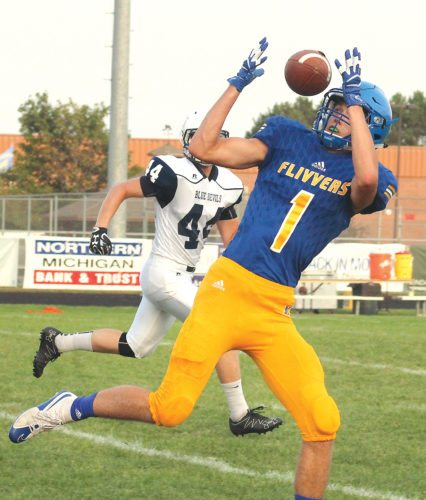 Kingsford's Chase Kreski catches a pass from Sawyer Perpich in Friday's 35-0 shutout of Sault Ste. Marie. (Theresa Proudfit/The Daily News)