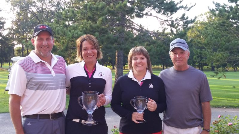 Courtesy Photo/Oak Crest Golf Course  Jim and Kristie Markell, left, won the 29th annual UP Husband & Wife Tournament at Oak Crest Golf Course in Norway. Larry and Kathy Gagnon took second.