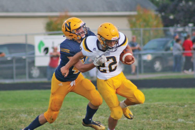 Negaunee's Jake Hill, left, tackles Iron Mountain's Adrian Barraza Friday in Negaunee. (Rachel Oakley/The Mining Journal)