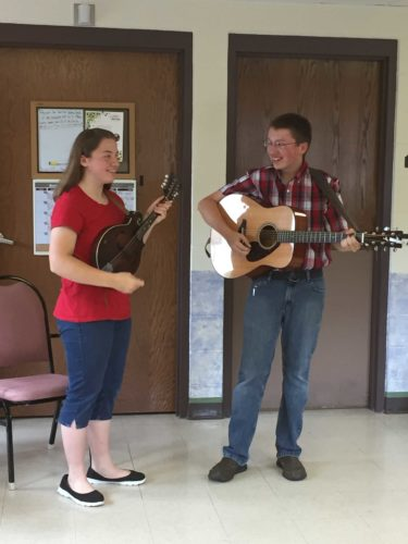 Residents of Freeman's Nursing and Rehabilitation in Kingsford recently enjoyed the picking and fiddling of Claire and Cole Neeley. The siblings performed toe-tapping bluegrass and gospel selections that energized everyone who listened. Claire, shown with her mandolin — she also played the violin — and Cole, on guitar, are volunteering regularly at the facility.