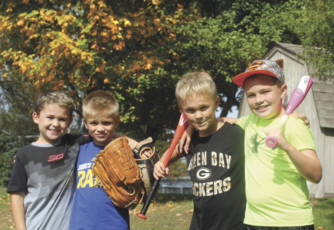 Above, from left, friends Bradlee Bottesi, Caleb Laurila, Lucas Menza and Jack Spreen took advantage of a sunny Monday afternoon to play a neighborhood game of baseball off Oakcrest Drive in Kingsford. (Theresa Proudfit/Daily News photo)