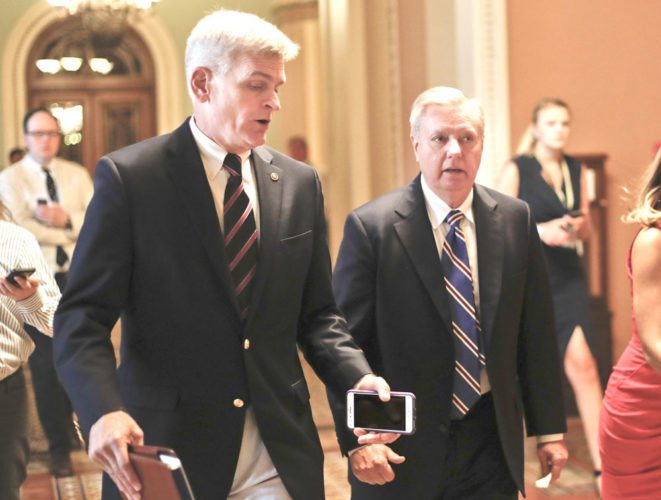 AP Photo SEN. BILL CASSIDY, R-La., left, and Sen. Lindsey Graham, R-S.C., right, talk while walking to a meeting on Capitol Hill in Washington in July. Senate Republicans are planning a final, uphill push to erase President Barack Obama's health care law. Graham and Cassidy are leading the new GOP charge and they'd transform much of Obama's law into block grants and let states decide how to spend the money.