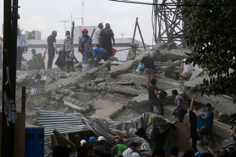 VOLUNTEERS SEARCH A building that collapsed in the Roma neighborhood of Mexico City after a magnitude 7.1 earthquake rocked central Mexico on Tuesday. (AP Photo/Eduardo Verdugo)