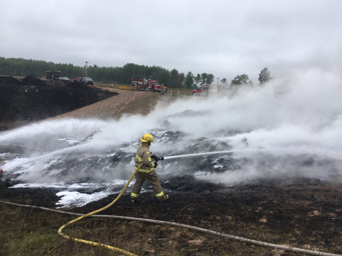 FIREFIGHTERS EXTINGUISH A fire in a shredded tire pile at the Niagara Development landfill off Kimberly Road in Quinnesec. (Submitted photo)