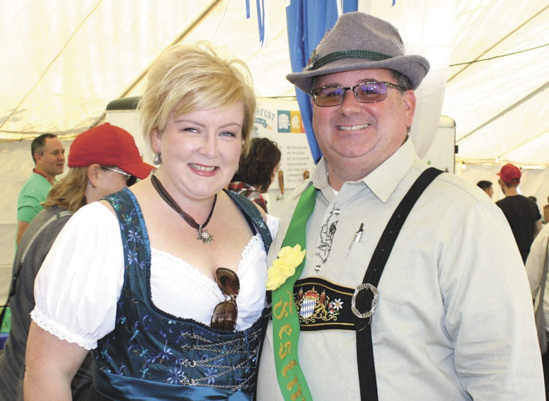 FESTMEISTER MARK KLOSSNER and his wife, Kellie, both dressed in authentic German clothing, are ready for another fun day of competitions, music, food and drink at Oktoberfest, set for 11 a.m. to 11 p.m. Saturday in the parking lot near the stage in downtown Iron Mountain. (Submitted photo)