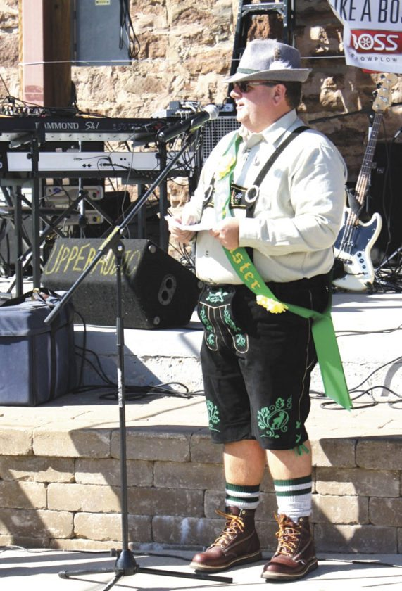 FESTMEISTER MARK KLOSSNER leads chants and songs at last year's Oktoberfest in downtown Iron Mountain. (Submitted photo)