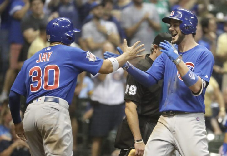Chicago Cubs' Kris Bryant is congratulated by Jon Jay after hitting a two-run home run during the 10th inning of a baseball game against the Milwaukee Brewers on Thursday in Milwaukee. (AP Photo/Morry Gash)