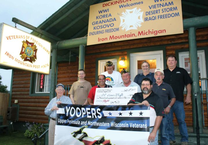 The Disabled American Veterans presented a check for $1,590 to the U.P. Honor Flight. Pictured in the front, from left, are Leonard Reed and Jason Henderson; middle, Mike Bachand, Scott Knauf, U.P. Honor Flight president, Doug Powell and Ron Zahn; back, DAV members Eugene Cavacioni, Russ Rosenburg and Joe Marczak. Honor Flight XIII will be take place Sept. 27.