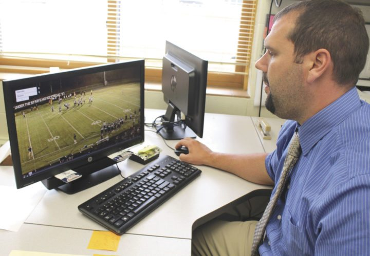 Joe Tinti, Norway High School principal and athletic director, demonstrates the Pixellot system that will be used to livestream sporting events in the district.  Cameras are located at the football field and high school gym. (Theresa Proudfit/Daily News Photos)