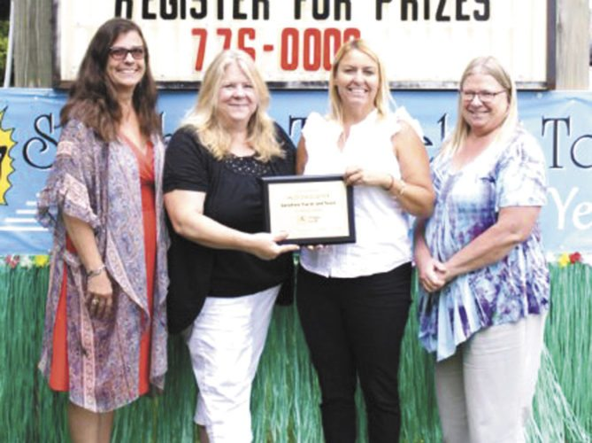 LOCAL TRAVEL AGENCY, Sunshine Travel & Tours has been named to the 500 Club for its work in supporting the brands of The Mark Travel Corp.  From left, are Dawn Griggs, travel consultant; Michelle Valeski, owner/manager of Sunshine Travel; Michelle Payette, business development manager for The Mark Travel Corp; and Tracy Schultz, travel consultant.