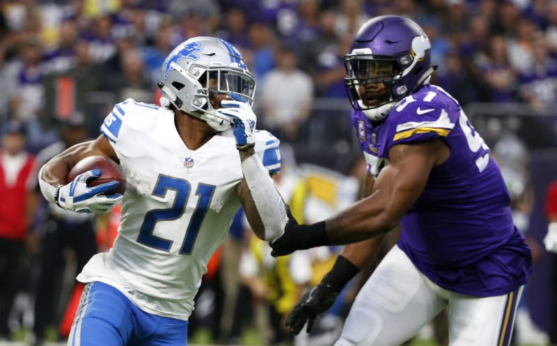 Detroit Lions running back Ameer Abdullah, left, runs from Minnesota Vikings defensive end Everson Griffen, right, on Sunday in Minneapolis. (AP Photo/Bruce Kluckhohn)