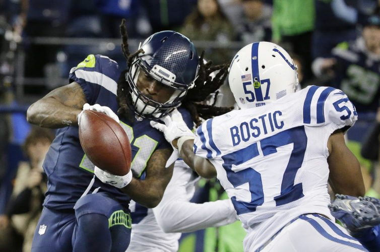 Seattle Seahawks' J.D. McKissic, left, makes a catch behind Indianapolis Colts inside linebacker Jon Bostic (57) for a touchdown on Sunday in Seattle. The Seahawks won 46-18. (AP Photo/Elaine Thompson)