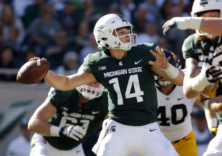 Michigan State quarterback Brian Lewerke throws a pass against Iowa during the first quarter on Sept. 30 in East Lansing, Mich. (AP Photo/Al Goldis)